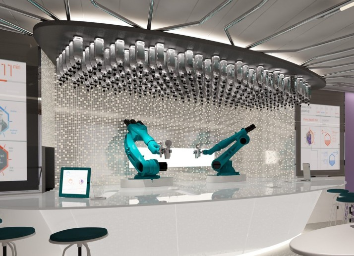 Metal bar: The robotic bar tenders prepare your cocktail