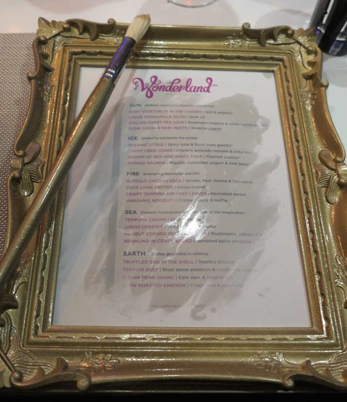 Taste of what's to come: It takes a bit of magic (well, a paint brush and water) to make the Wonderland menu appear